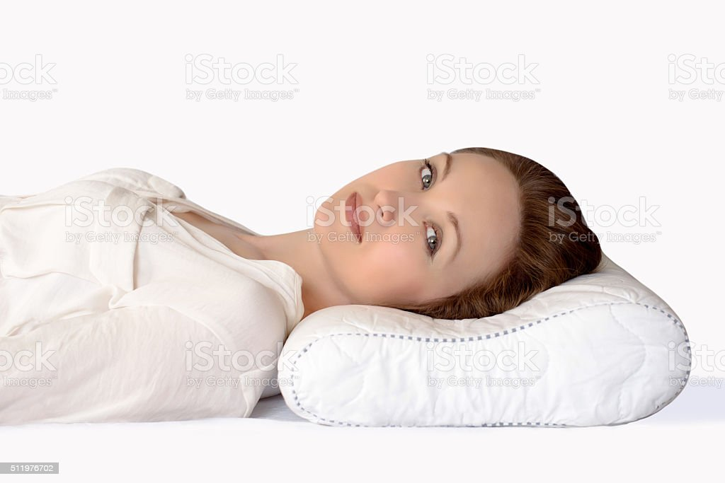 young woman sleeping on an orthopedic pillow stock photo