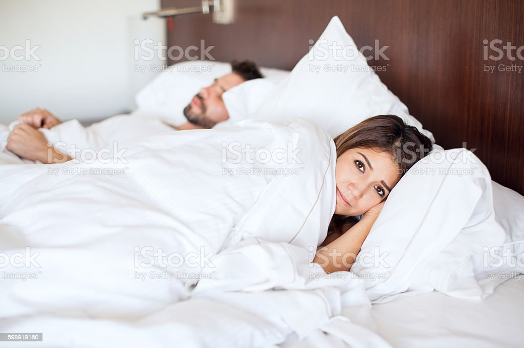 Young woman sleeping with a guy stock photo