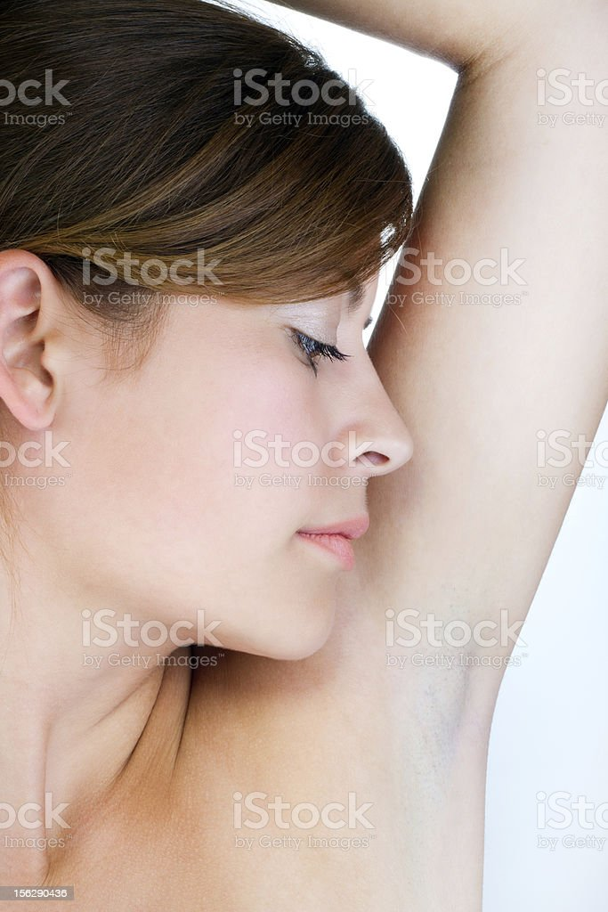 Young woman smelling her armpit royalty-free stock photo