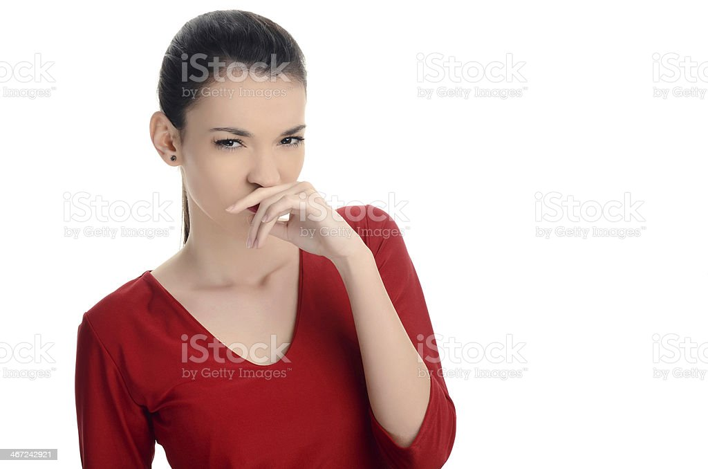 Young woman smelling something bad. Dissgusting odor. stock photo