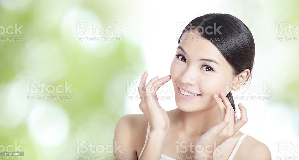 Young woman smile and hand touch face stock photo