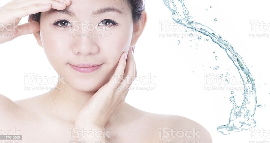 Young woman smile face skincare with splash of water royalty-free stock photo