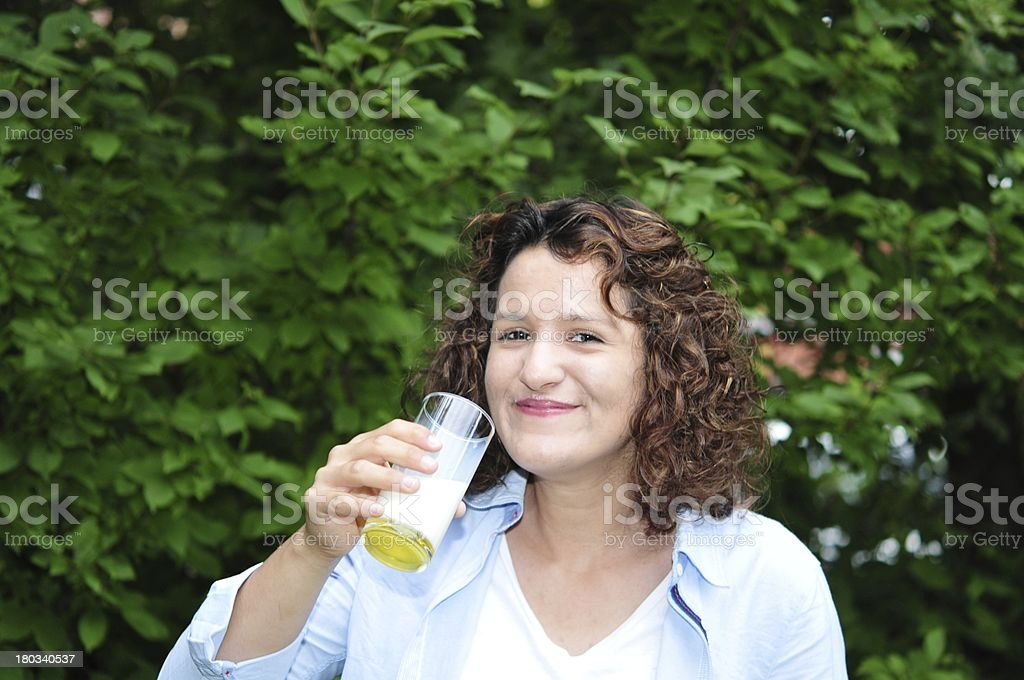 Young woman smiles after she has drunken milk stock photo