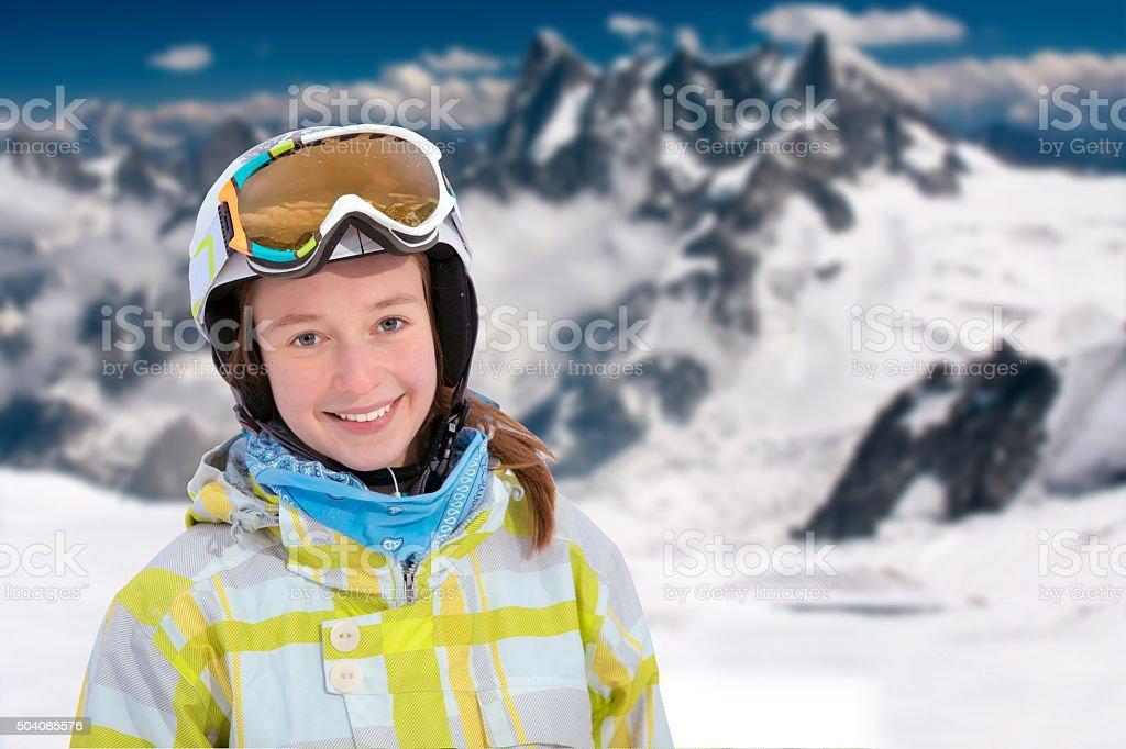 Young woman smiling at a ski resort stock photo