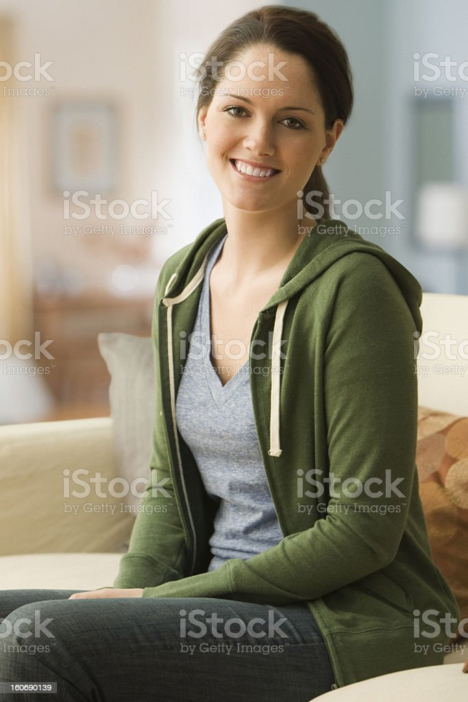 Young woman smiling at home royalty-free stock photo