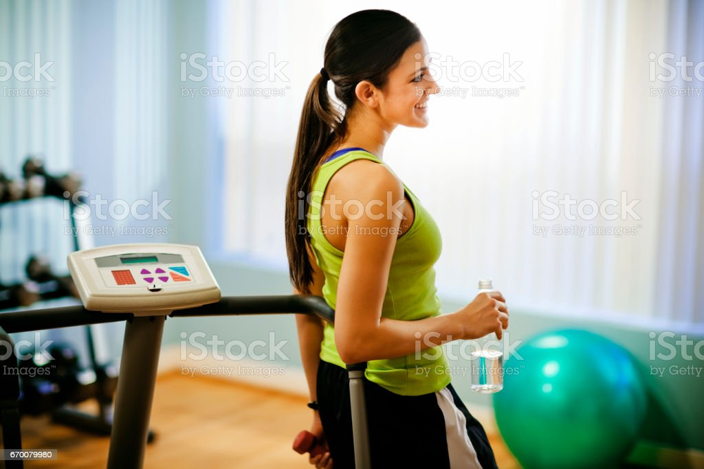 Young Woman Smiling at the Gym stock photo