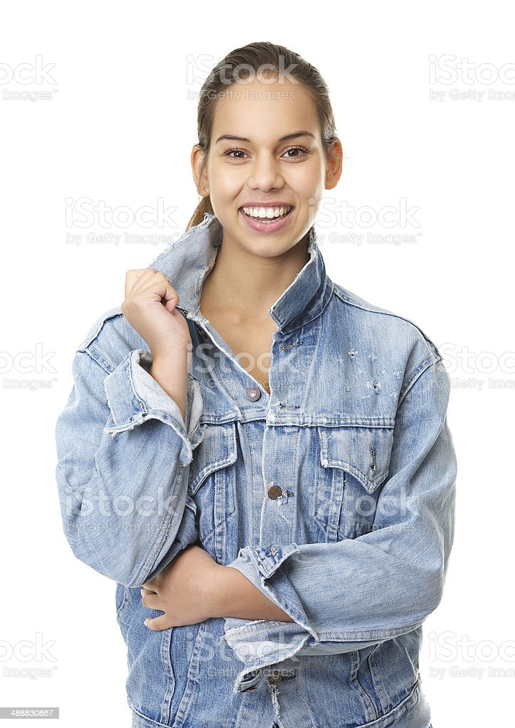 Young woman smiling in denim jeans jacket stock photo
