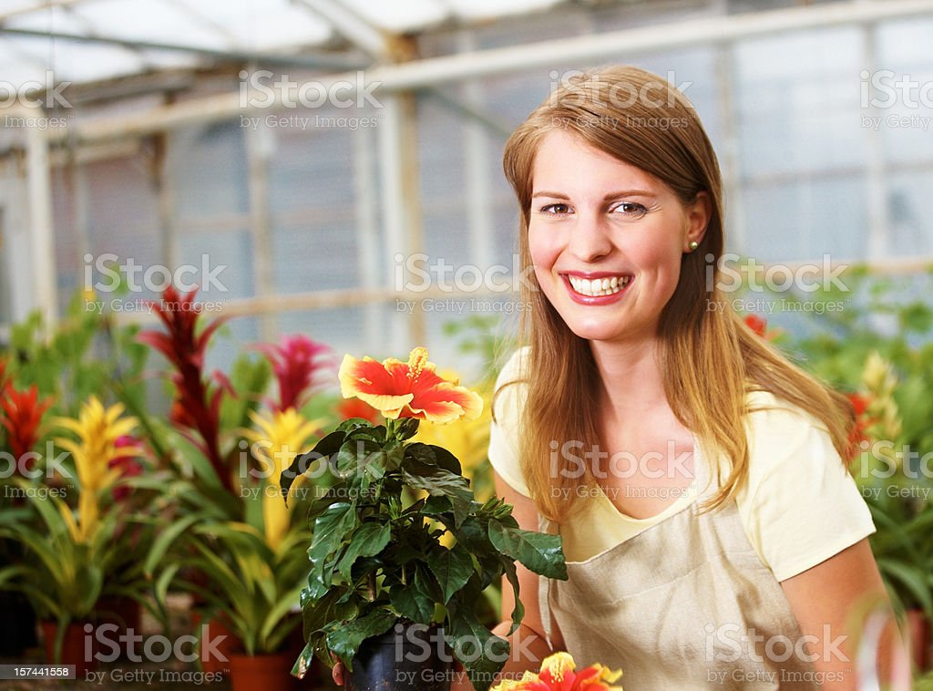 Young woman smiling in plants nursery royalty-free stock photo
