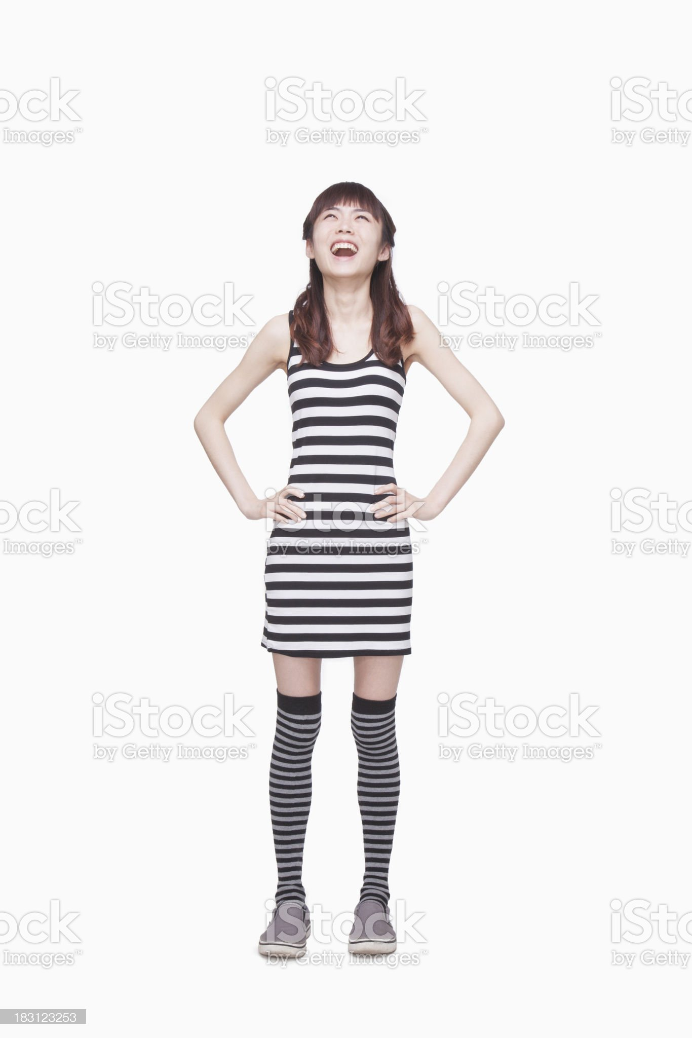 Young Woman smiling looking up royalty-free stock photo