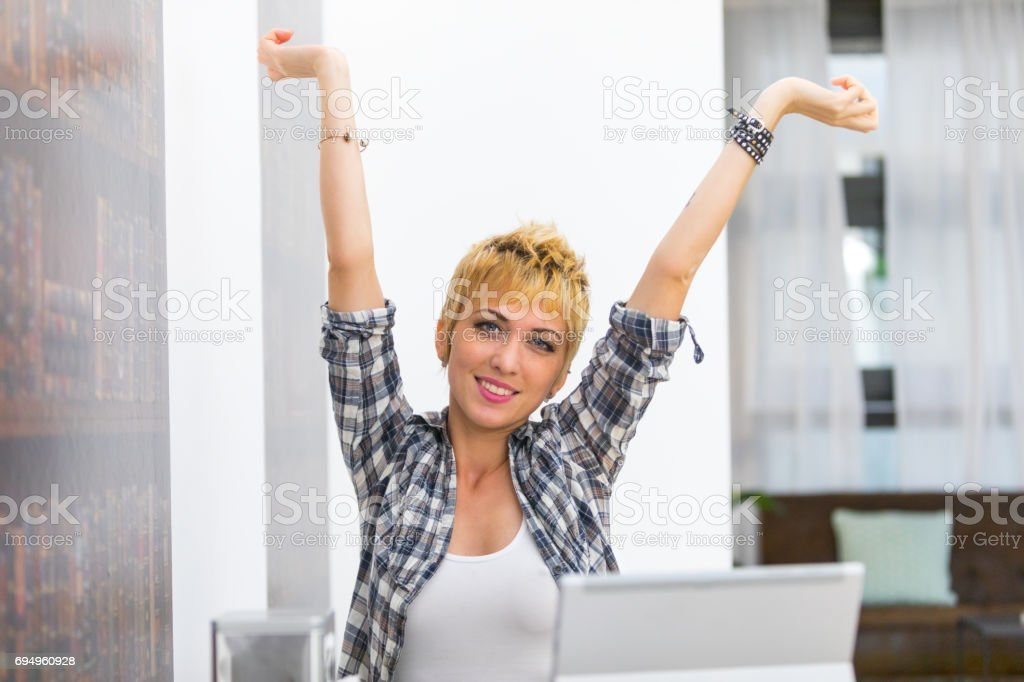 Young woman smiling with outstretched arms stock photo
