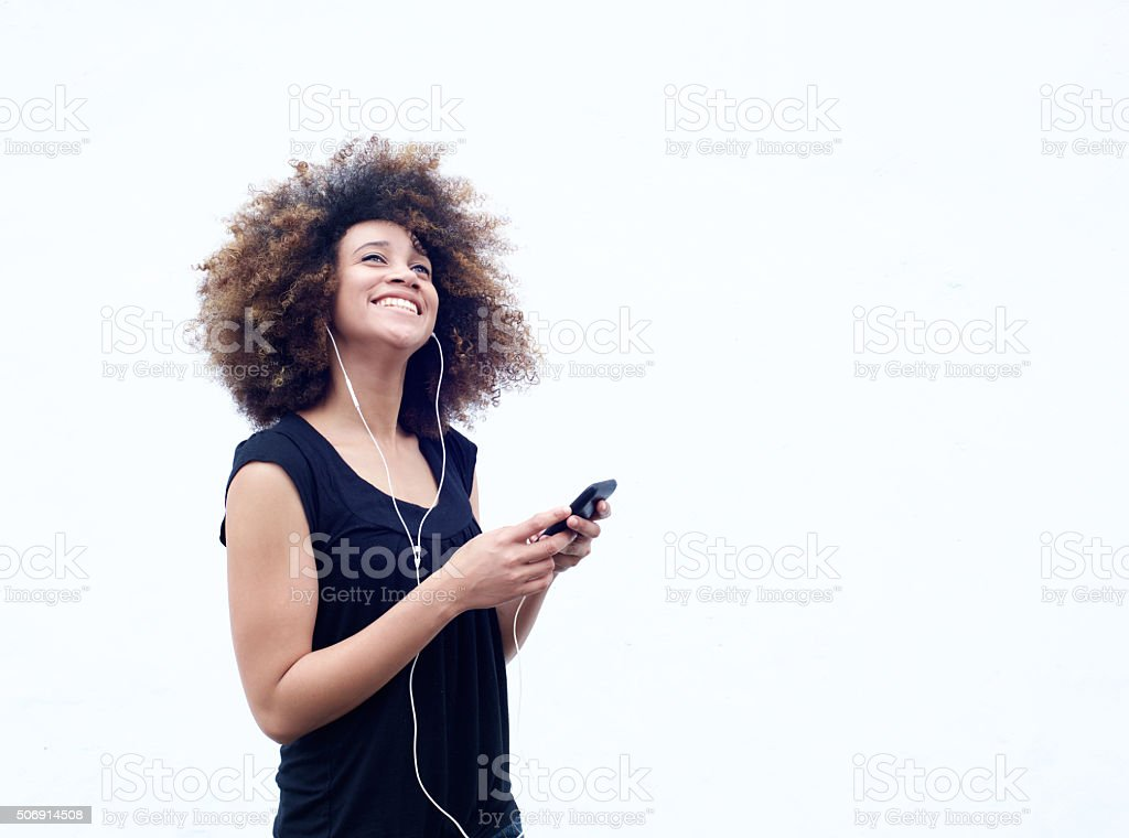 Young woman smiling with smart phone and mobile phone stock photo