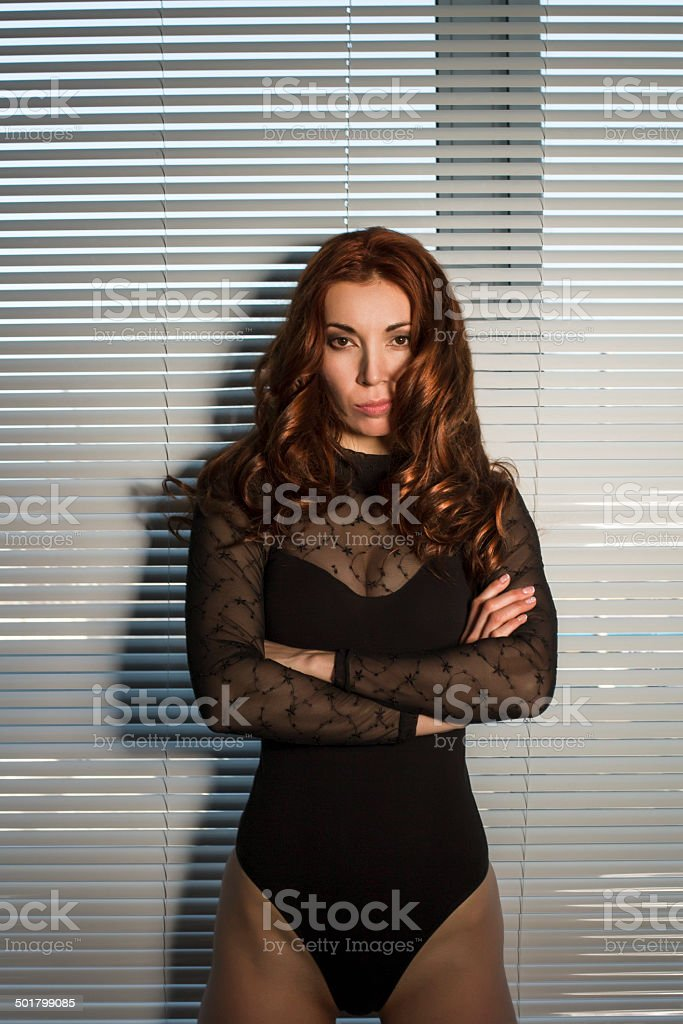 young woman smirking stock photo