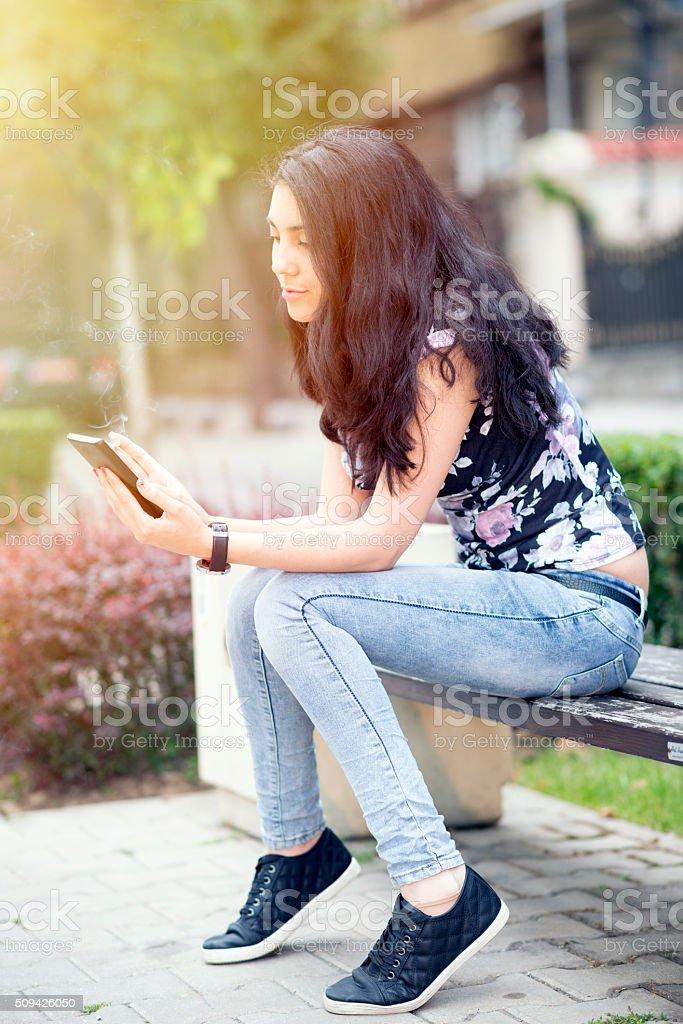 Young woman smoke stock photo