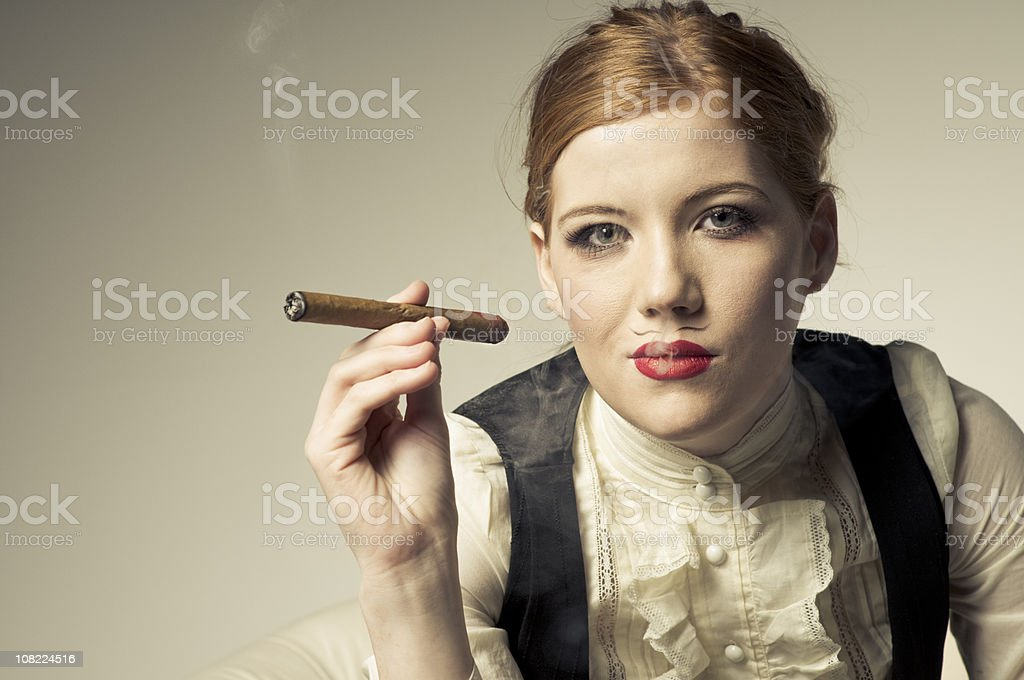 Young Woman Smoking Cigar royalty-free stock photo