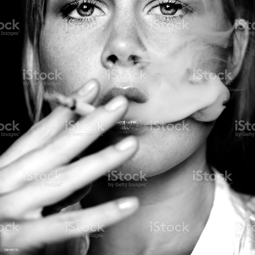 Young Woman Smoking Cigarette, Black and White stock photo