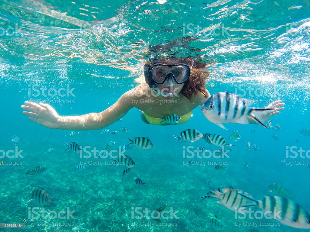 Young woman snorkeling stock photo