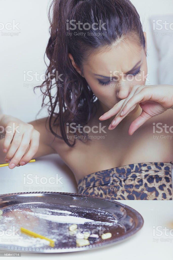 Young woman snorting cocaine stock photo