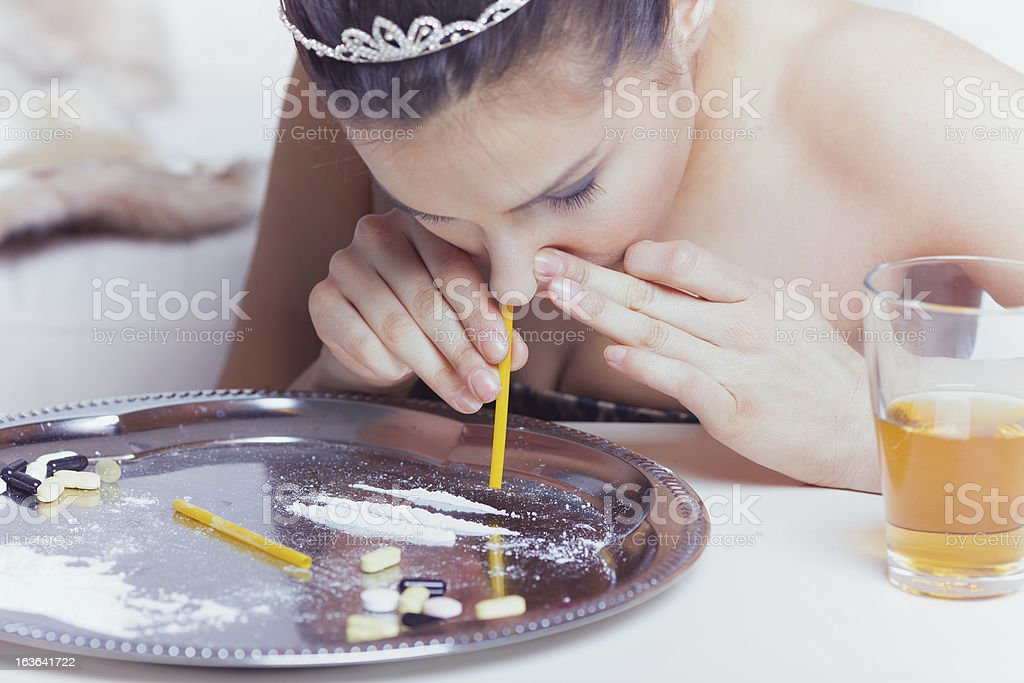 Young woman snorting cocaine royalty-free stock photo