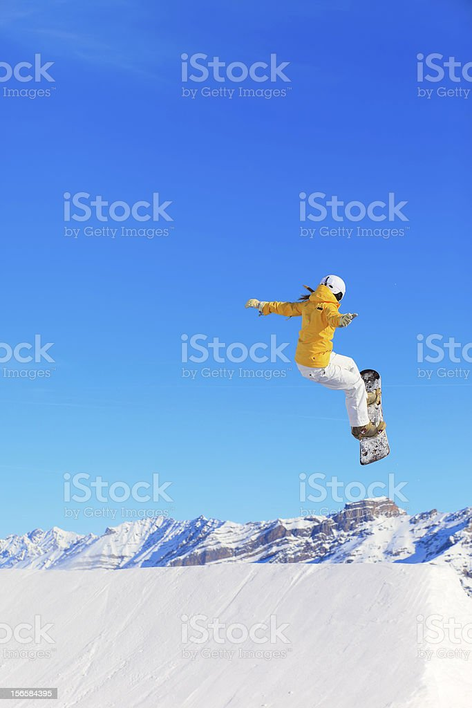 Young woman snowboarder royalty-free stock photo