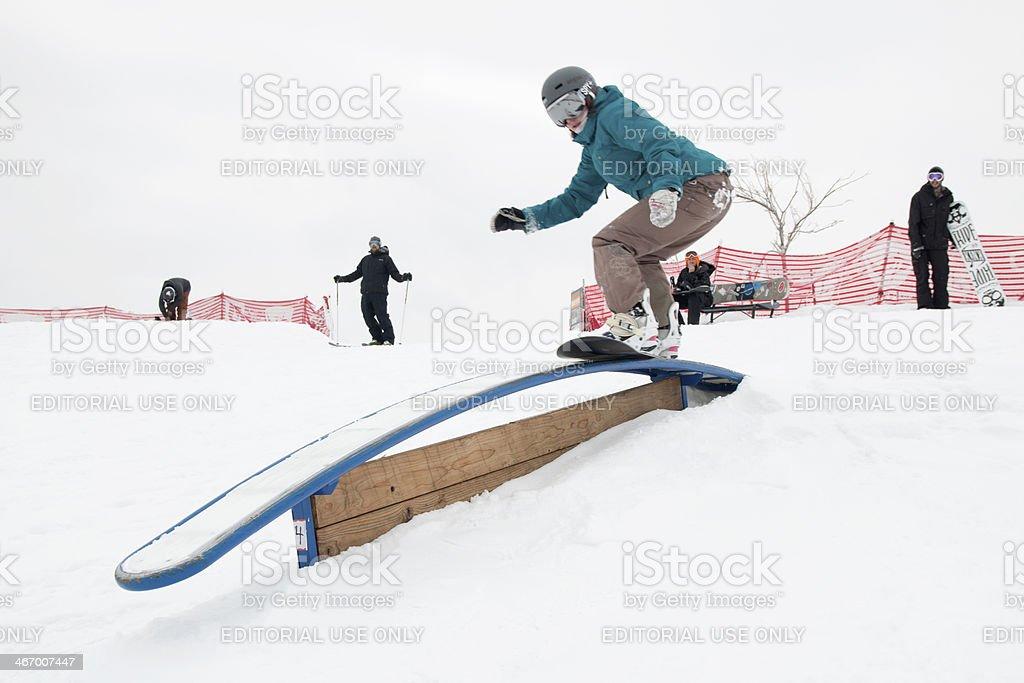 Young woman snowboarding the rails Denver Colorado stock photo