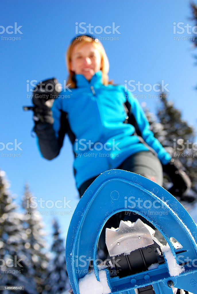 Young woman snowshoeing royalty-free stock photo