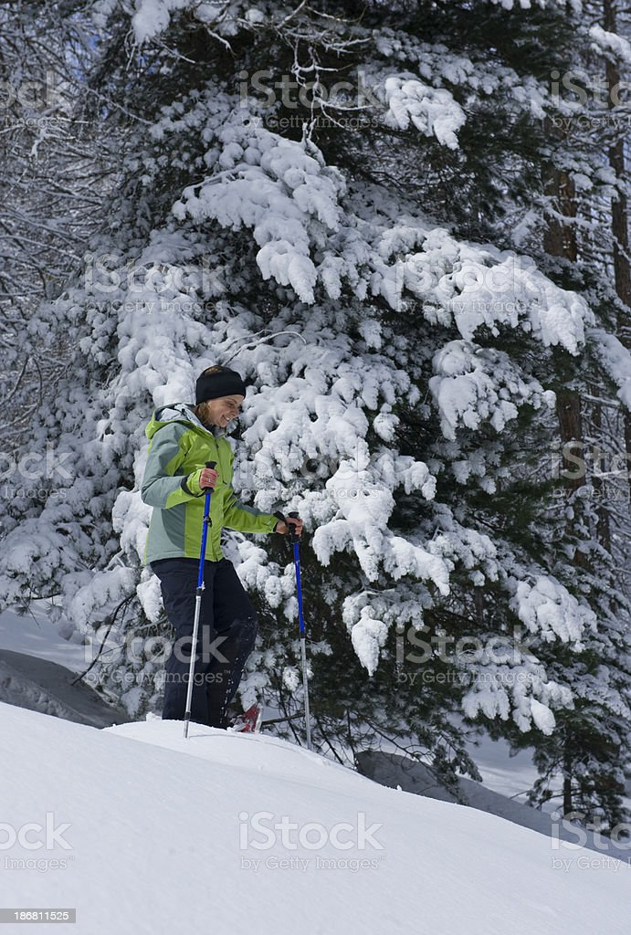 Young Woman snowshoes excursion royalty-free stock photo