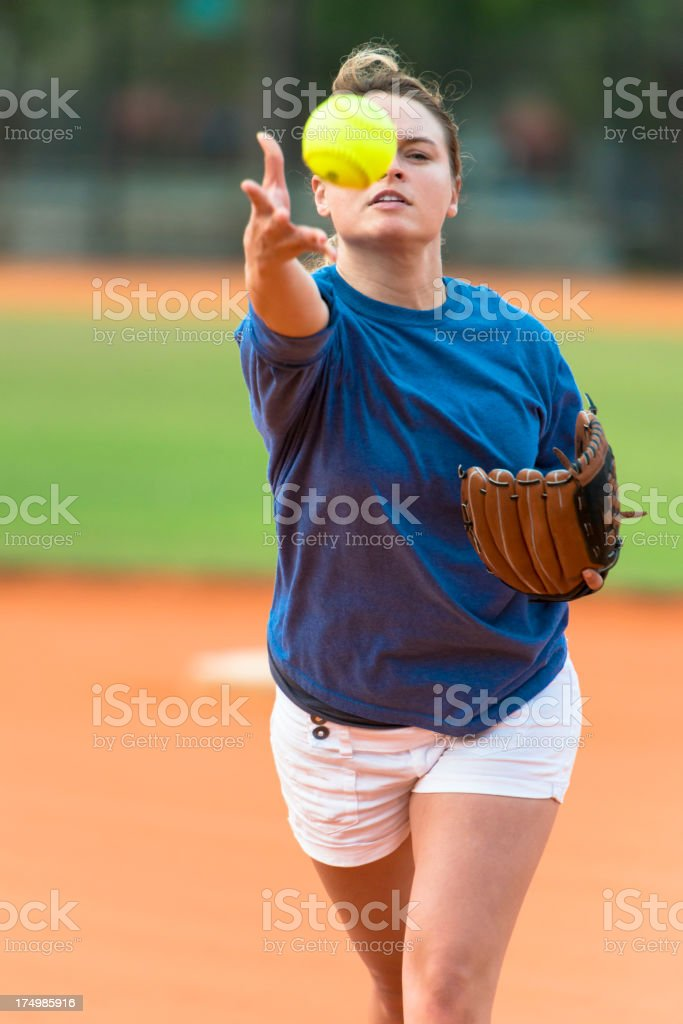 Young Woman Softball Player Pitcher Pitching Ball royalty-free stock photo