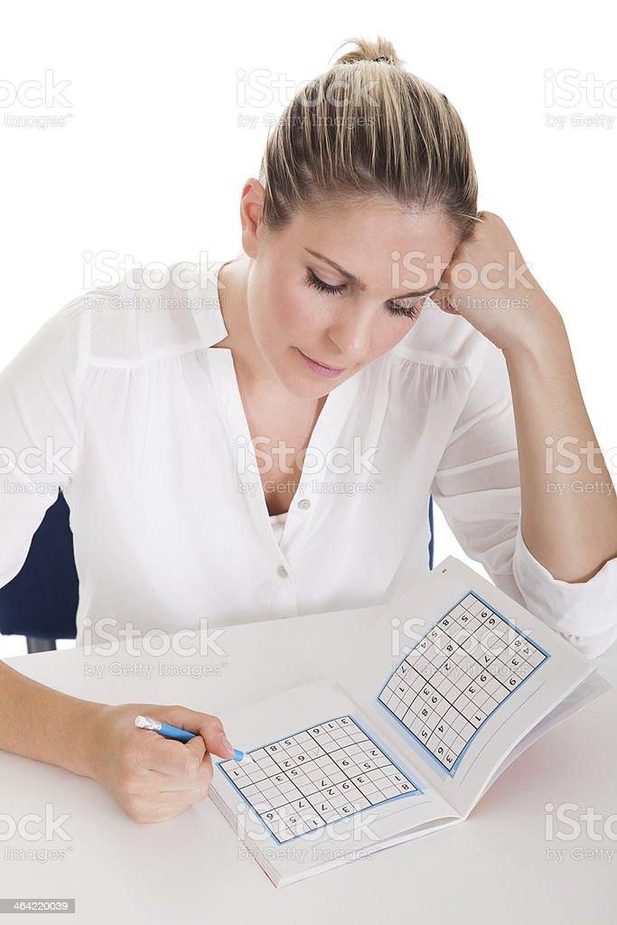 Young Woman Solving Sudoku royalty-free stock photo