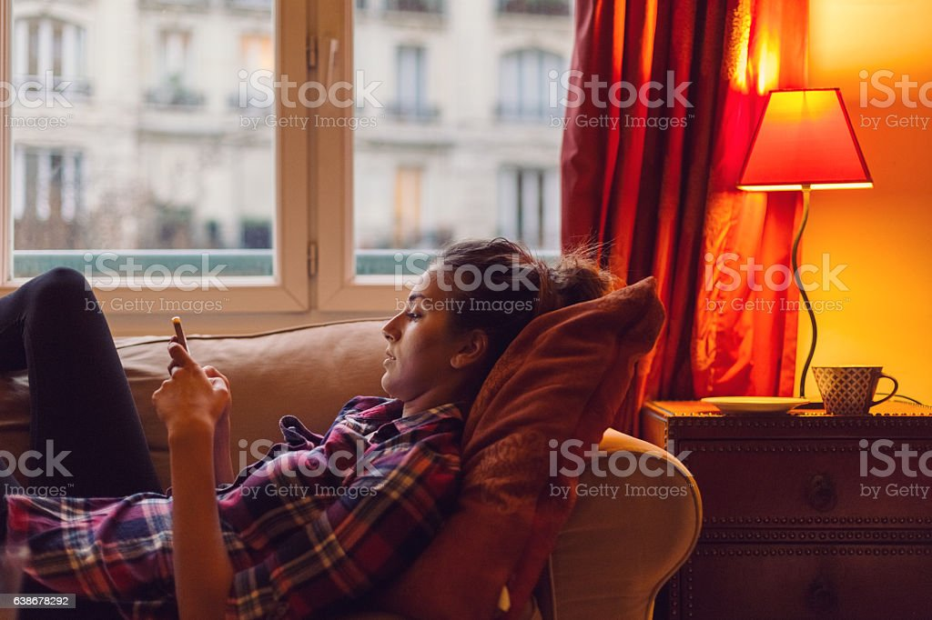 Young woman spending the weekend at home stock photo