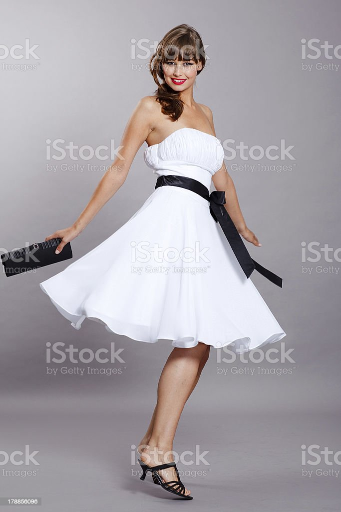 Young woman spinning around in sommer dress stock photo