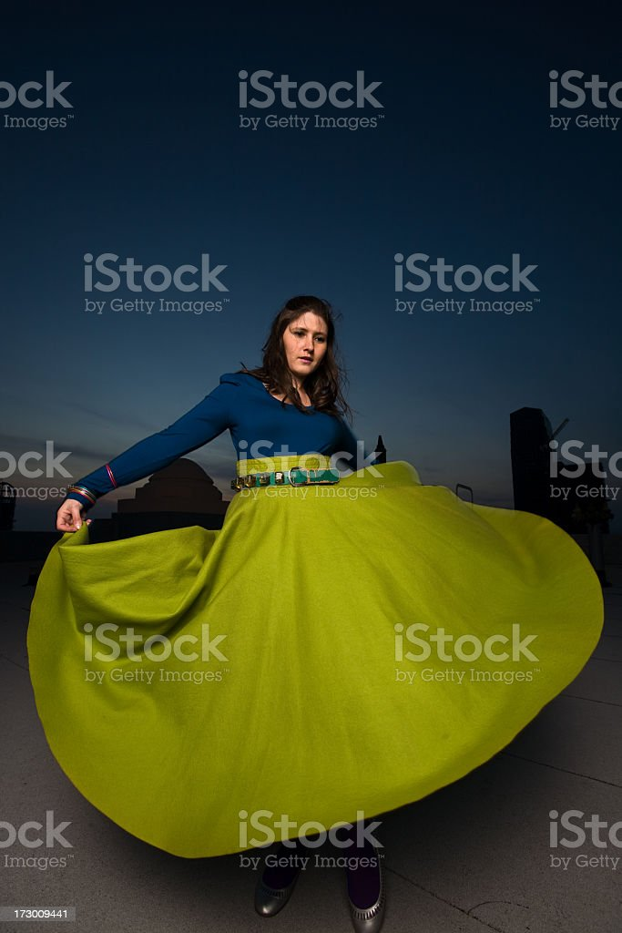 Young Woman Spinning on a Rooftop stock photo