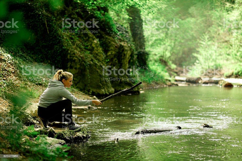 Young woman splash water stock photo