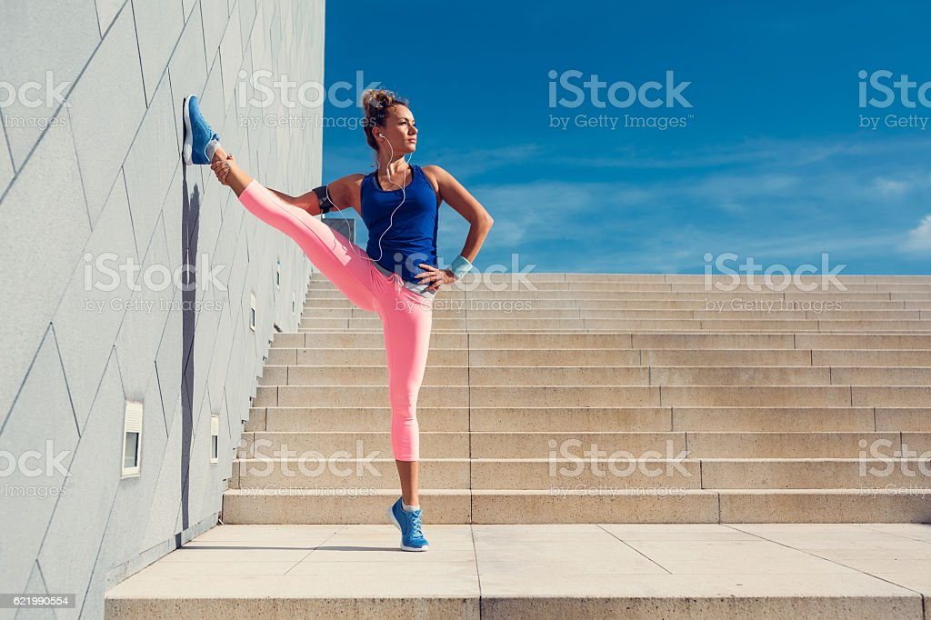 Young woman sports training in the city stock photo
