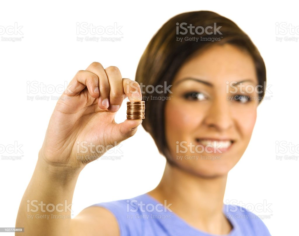 Young woman squeezes a stack of pennies. royalty-free stock photo