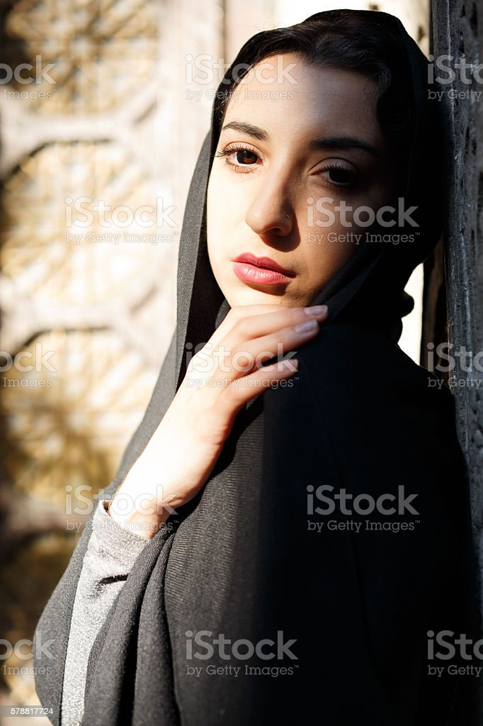 Young woman standing at the entrance to the temple stock photo