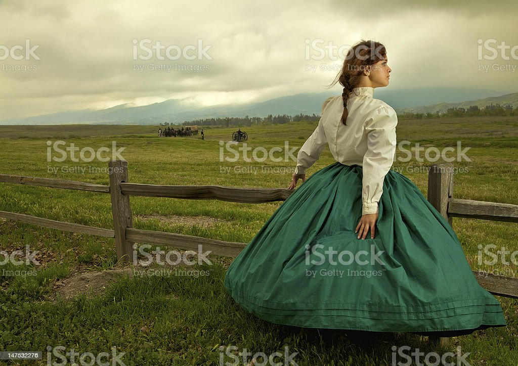 Young woman standing by a field during the Civil War stock photo