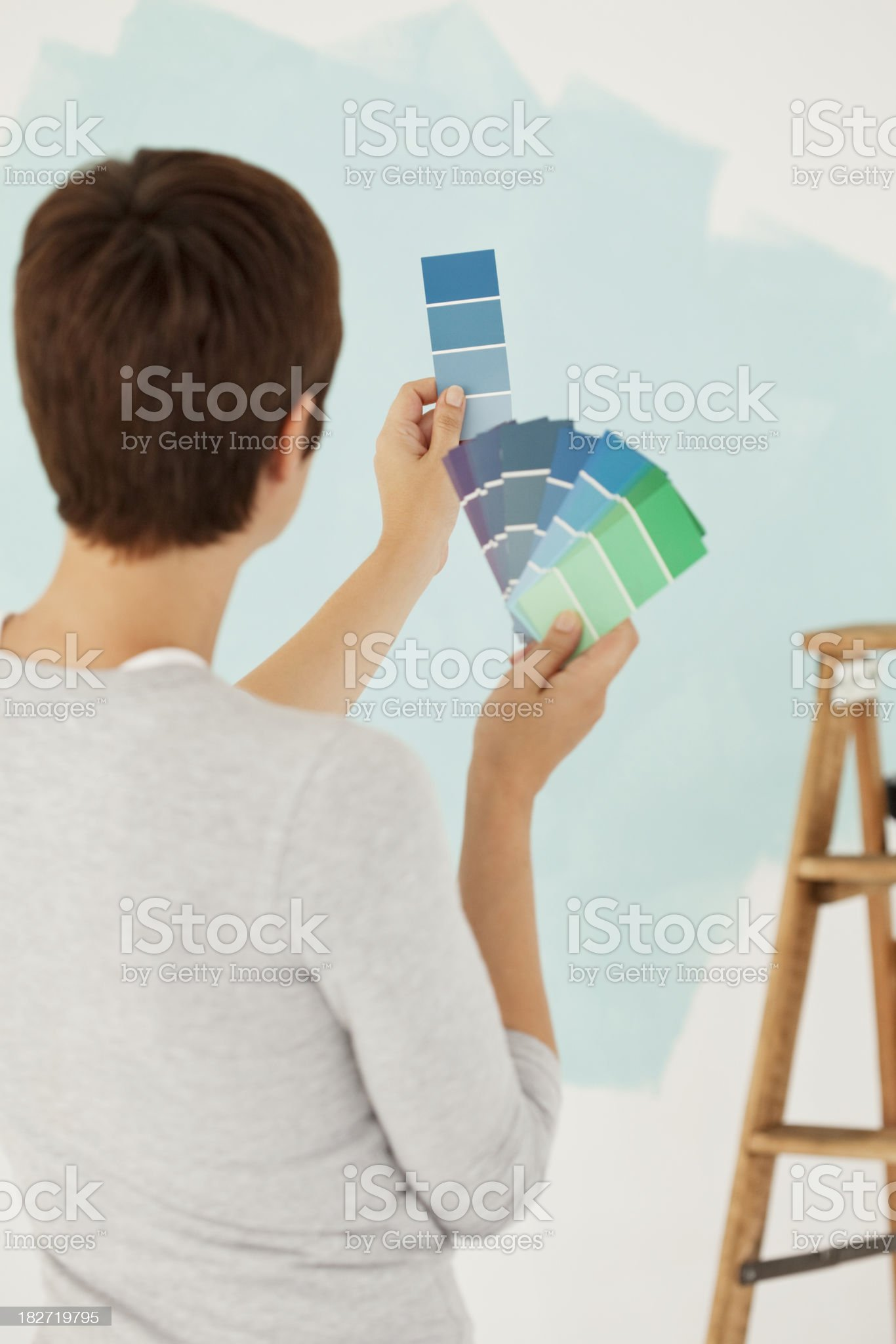 Young Woman Standing Holding Paint Samples royalty-free stock photo