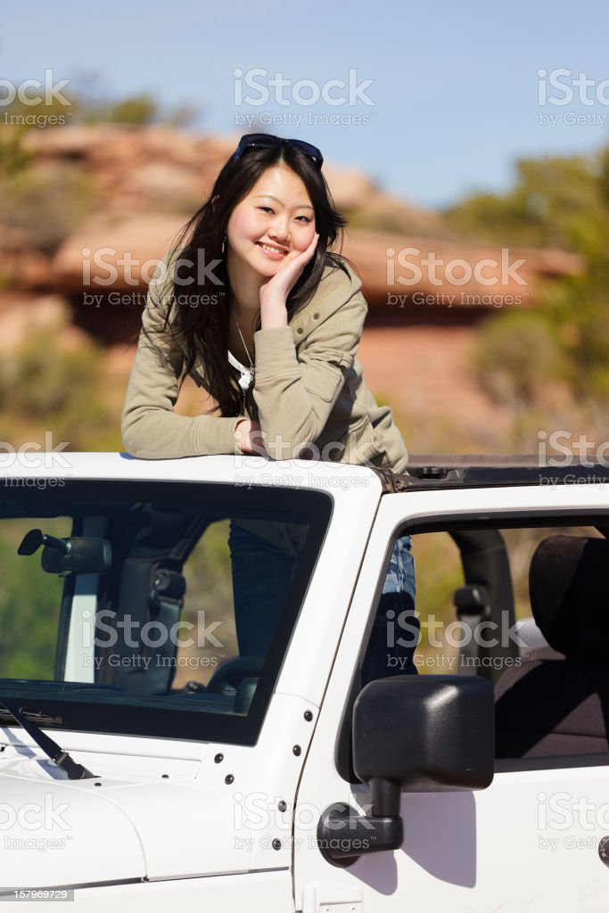 Young Woman Standing in an Off Road Vehicle stock photo
