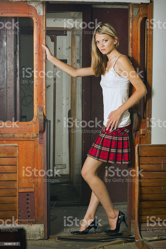 Young woman standing in doorway royalty-free stock photo