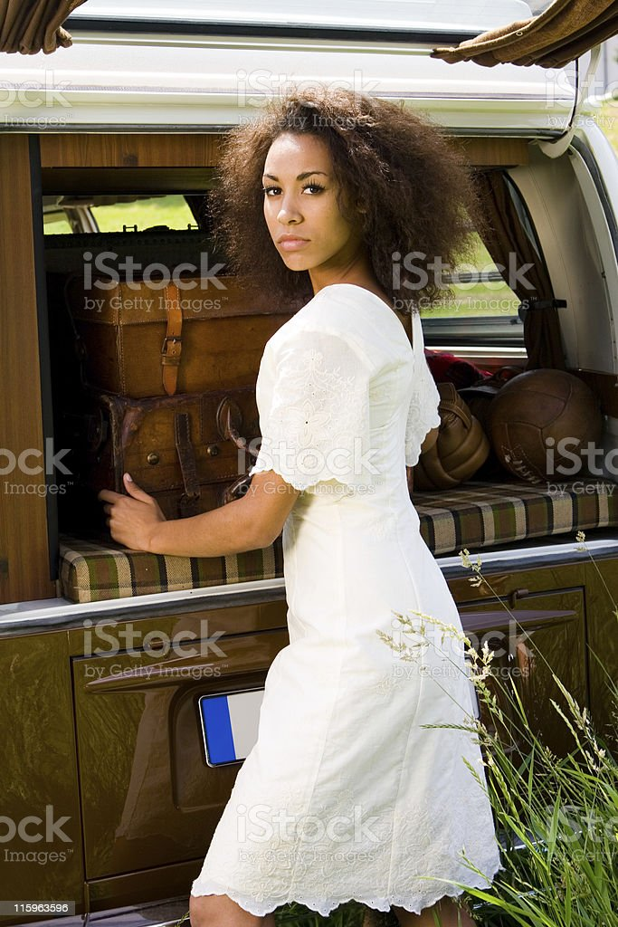 Young woman standing in front of a van royalty-free stock photo