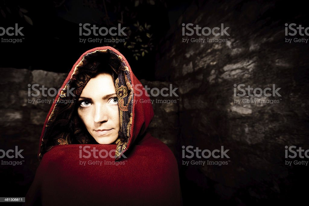 young woman standing in front of a wall stock photo