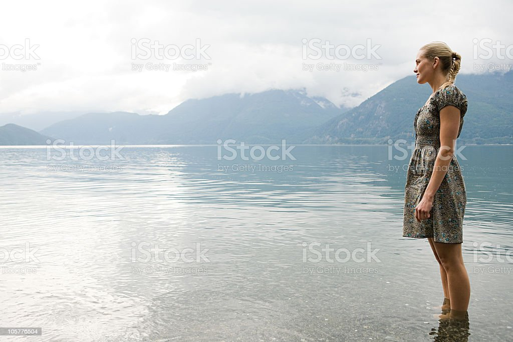 Young woman standing in lake royalty-free stock photo