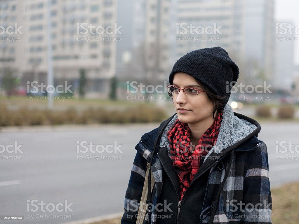 Young woman standing in the city street royalty-free stock photo