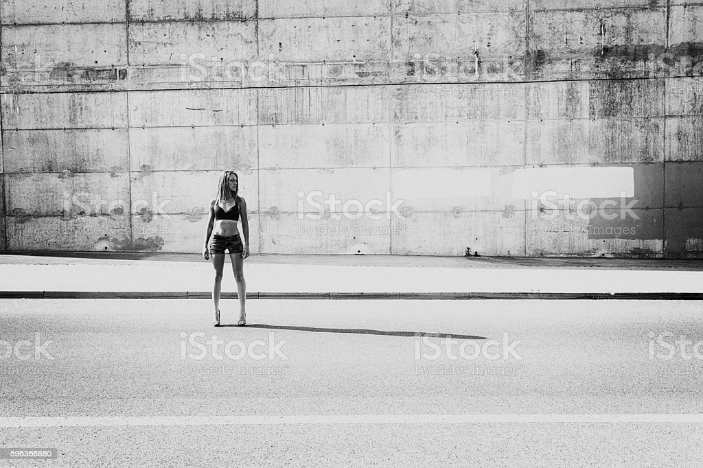 Young woman standing in the city street stock photo
