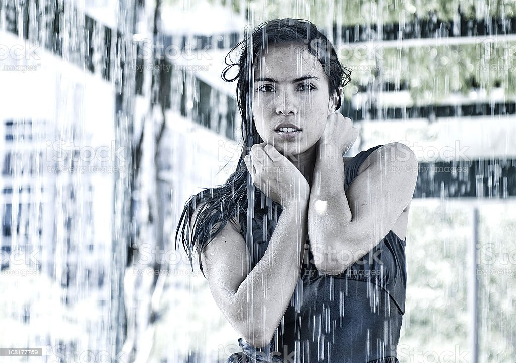 Young Woman Standing in the Rain royalty-free stock photo