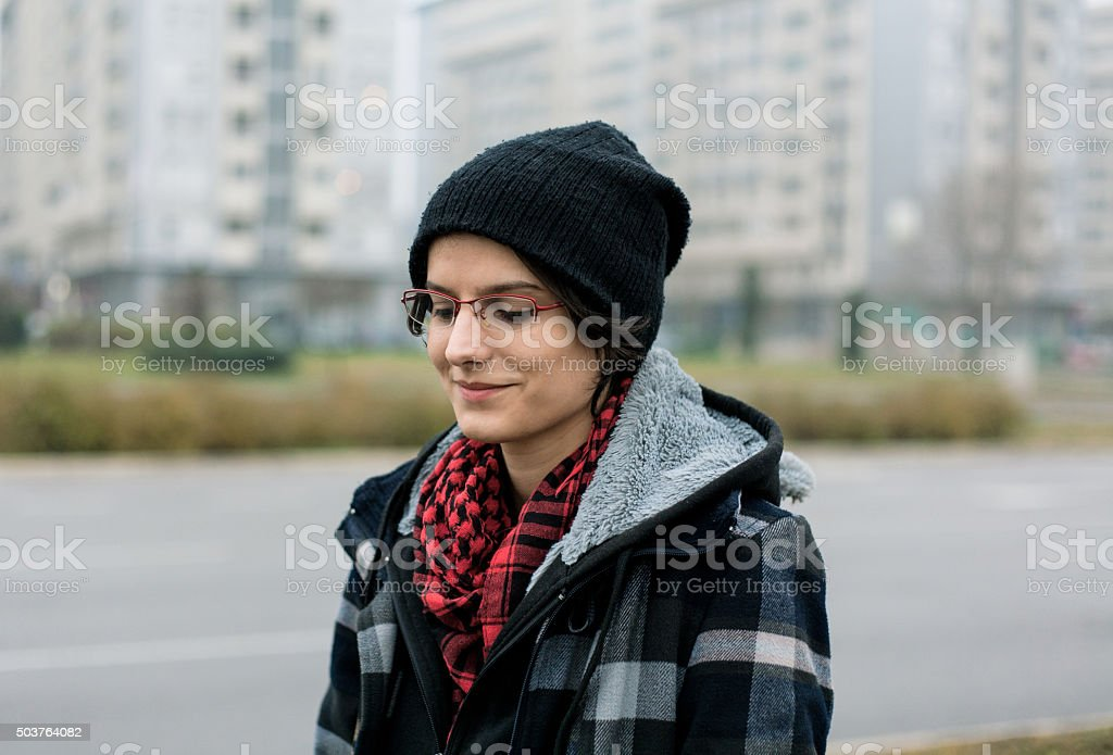 Young woman standing in the street royalty-free stock photo