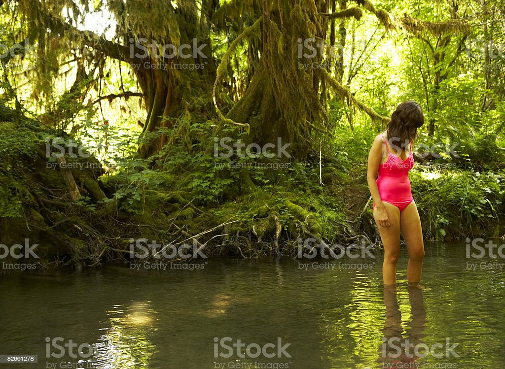 Young woman standing in water stock photo
