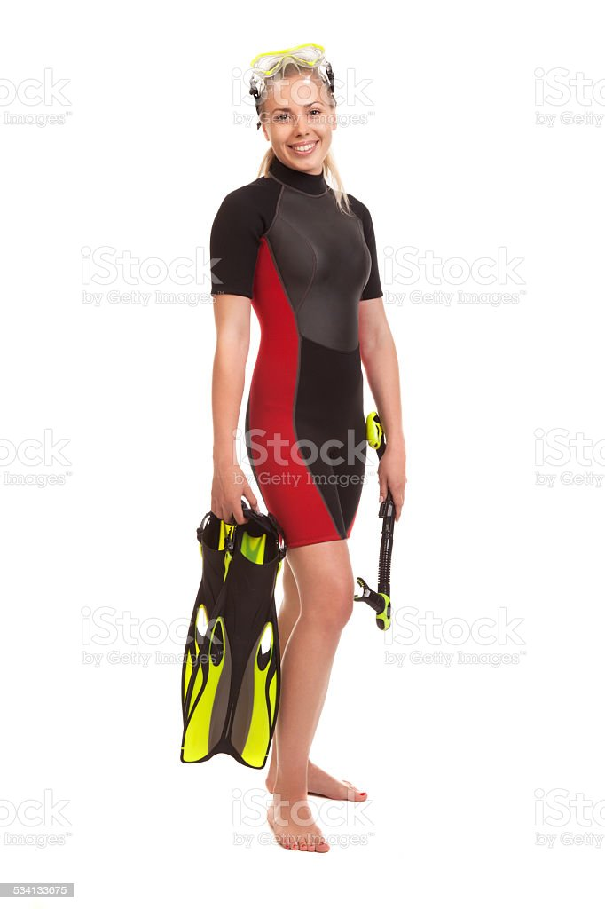 Young woman  standing in wetsuit  wearing, stock photo
