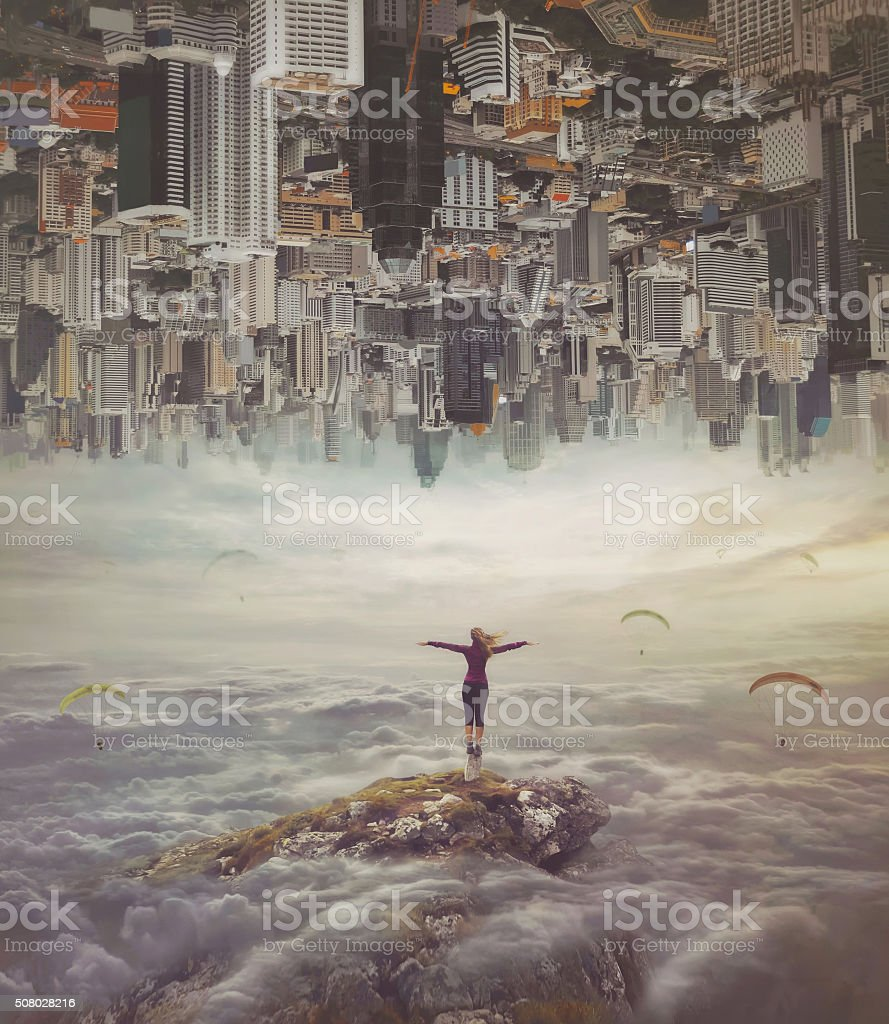Young woman   standing on a rock with divorced hands stock photo