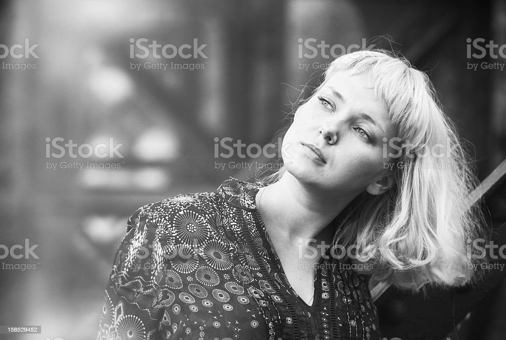 young  woman standing on bridge bearing royalty-free stock photo